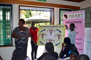 Lydiah Njoroge giving a demonstration of the menstrual monthly cycle